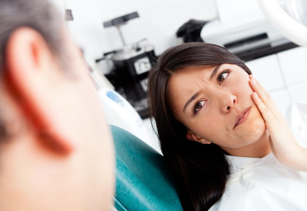 Woman with tooth pain | Emergency Dentist Temple TX