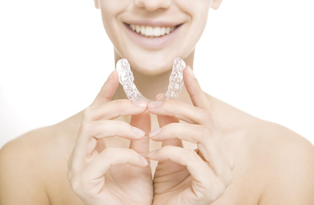 image of patient holding their invisalign invisible braces | Temple TX