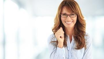 Woman with glasses smiling l Cosmetic dentistry Temple TX