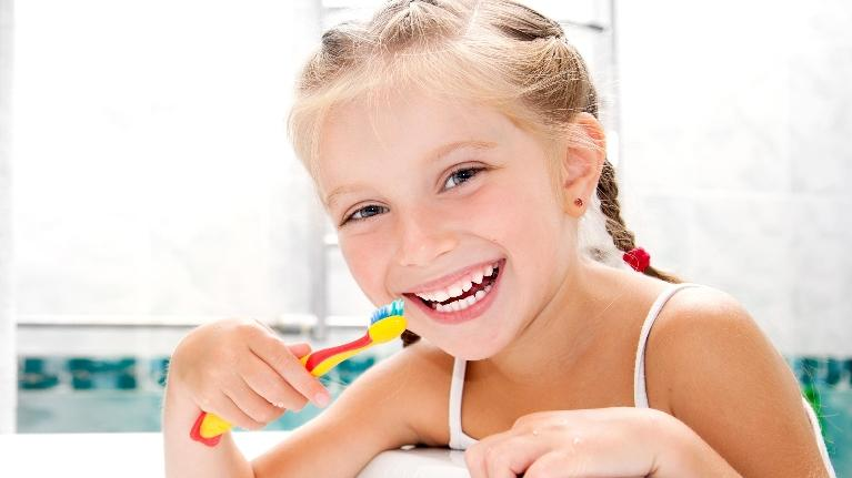 Girl brushing teeth | Childrens dentistry temple tx