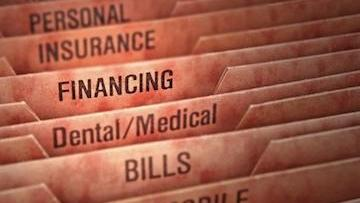Close up of file folder labels Financing highlighted l Dental financing Temple TX