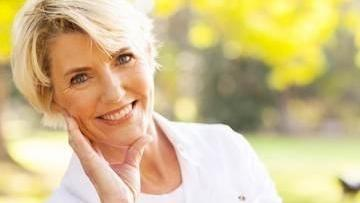 Older woman smiling outside I Invisalign Temple TX