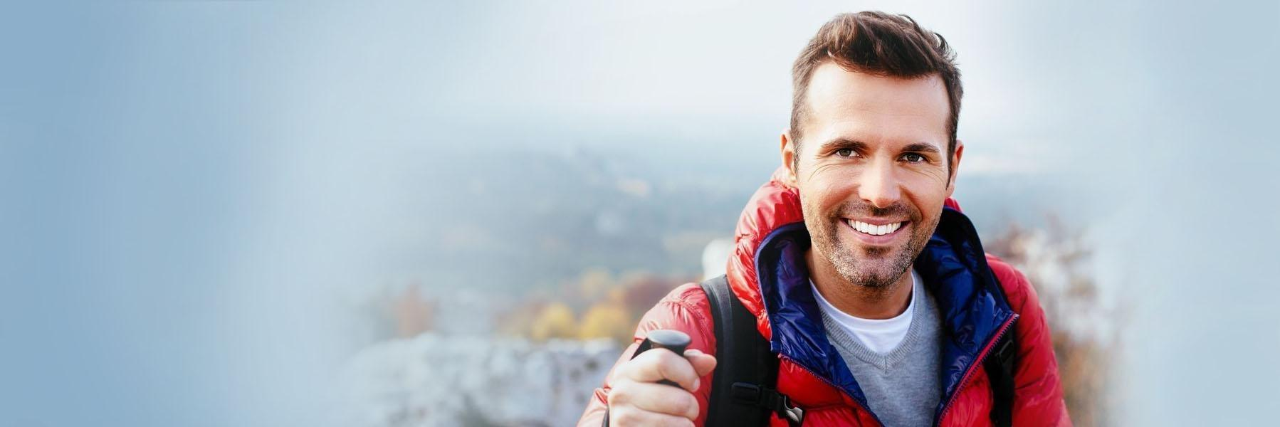 Man hiking and smiling l Cosmetic Dentist Temple TX