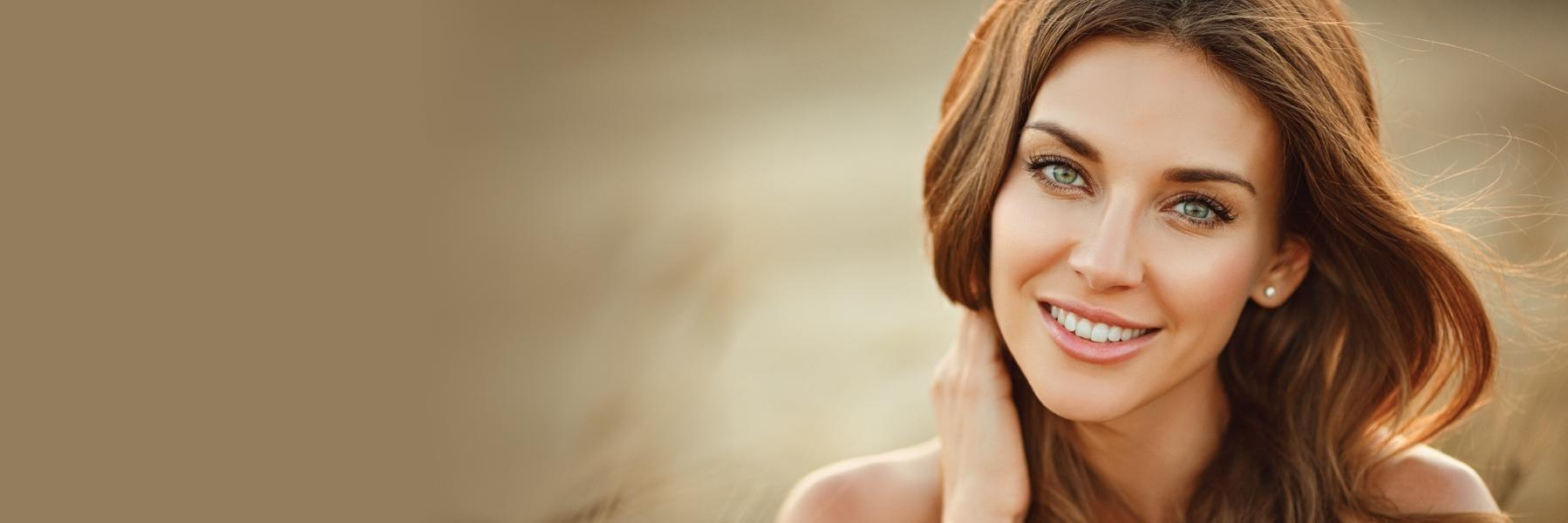 Woman with brown hair smiling l Dentist Near Me